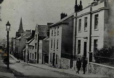 Upper part of Fore Street, Kingsbridge, showing substantial private houses and museum building c. 1910