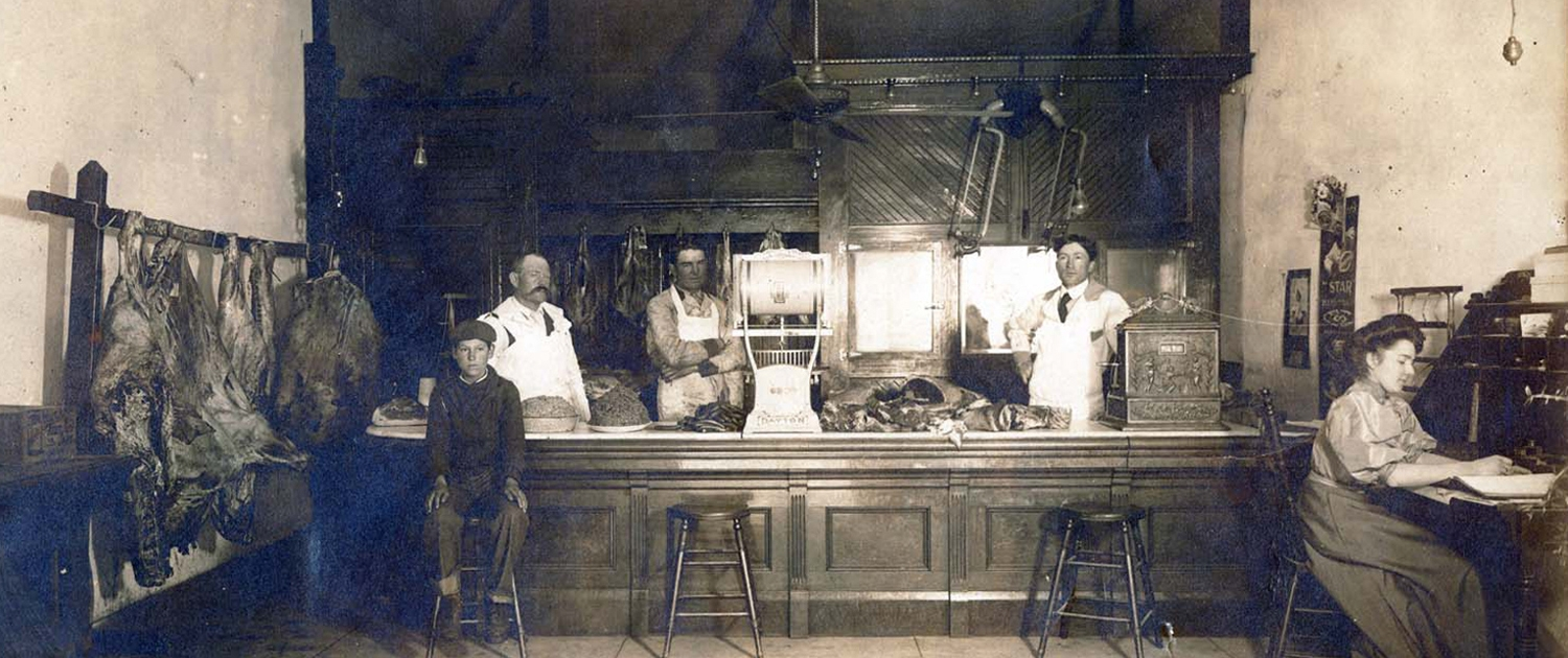Traditional butchers' shop with staff
