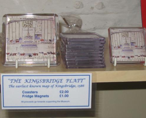 Coasters and fridge magnets showing the 'Kingsbridge Platt' the earliest known map of Kingsbridge from 1586