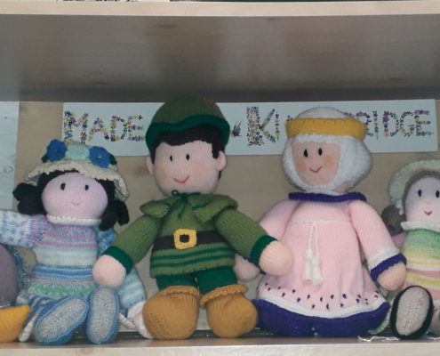 Large knitted toys and dolls on sale in the museum